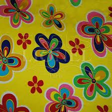 tissus motif paris carnaval fleurs colorés sur fond jaune tissus lionel