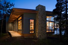 contemporary cantilevered lakefront cabin finne architects hgtv