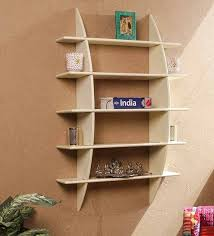 wall shelves pepperfry buy criss cross decorative wall shelf in cream finish by dream arts