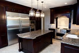 brown cabinets and black countertop fancy home design
