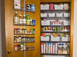pretty white color wooden kitchen storage pantry with double door