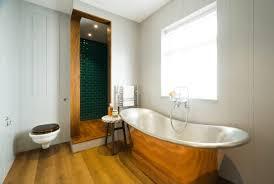 bathroom wooden flooring with dark wood also eye catching marbel