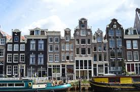canal houses of amsterdam history influence and current trends