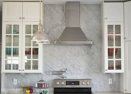 White Kitchen Marble Backsplash Boasts Carrera Fan Shaped Tiles - Marble backsplashes