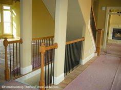 trendy inspiration open staircase to basement livingroom with