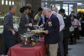 obama helps parents serve thanksgiving meals to veterans in