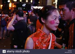 a dressed as chinese female ghost walk the street of lam kwai