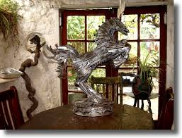 recycled metal statue sculpture made from knives and