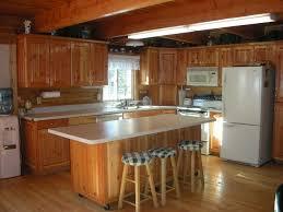 kitchen backsplash panels overhang white quartz kitchen island white refrigerator kitchen