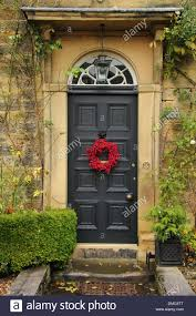 garland on front door of an country home in the