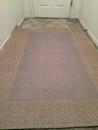Throw Rug On Top Of Carpet How To Secure An Area Rug Over Carpet Snapguide