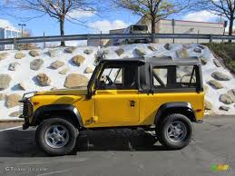 land rover defender 90 yellow 1997 aa yellow land rover defender 90 soft top 95116840 photo 2
