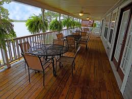 a large beautiful lakefront home with loads of porches and decks