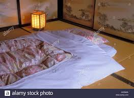 traditional japanese bedding known as a futon is used on top of