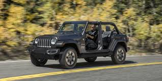 2018 jeep wrangler first look 2018 jeep wrangler adds capability loses weight