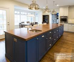 off white cabinets with a blue kitchen island omega blue kitchen