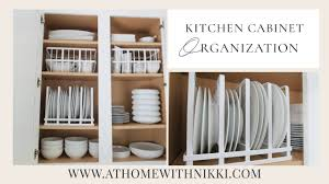 how do you arrange dishes in kitchen cabinets kitchen cabinet organization organize with me