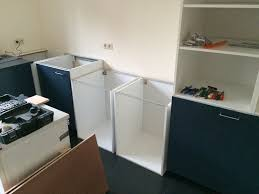 ikea kitchen cabinets laundry room hacking laundry room cabinets and washer dryer pedestal