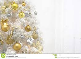 white christmas tree with gold decoration on white background