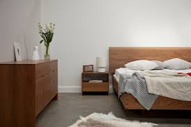 Floating Bedframe by Wood Floating Bed And Wood Cabinet Of Modern Simple Bedroom Design