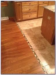 hardwood floor transition between uneven rooms flooring home