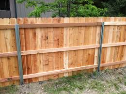 steel posts postmaster with cedar privacy fence back side a
