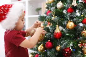Decoration Christmas Hat by Little Boy With Santa Hat Decorating Christmas Tree Stock Photo