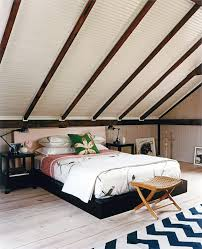 attic remodel bedroom rustic with sloped roof red desk lamps