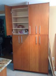 tall pantry cabinet broom closet in cabinetry tall pantry