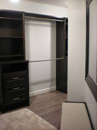 modern black closet with 3 drawers ideas in the cornier space