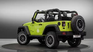 dark green jeep wrangler jeep wrangler rubicon and renegade receive mopar treatments for paris