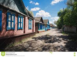 one storey houses stand along the road in the village stock photo