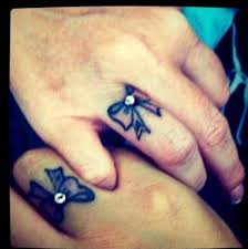 delicate body art dainty finger tattoos