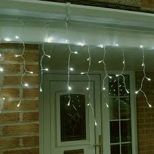 twinkling white led icicle lights metre led icicle lights in warm white connectable 320 led s
