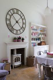 small corner hutch dining room descargas mundiales com giant wall clock and corner hutch add personality to this dining room from paul 50