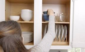 how do you arrange dishes in kitchen cabinets how to organize kitchen cabinets the home depot