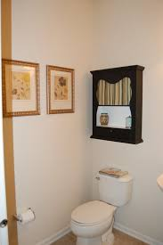 custom wood wall mounted tissue storage cabinet over toilet for