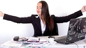 business woman doing exercises at her desk in the office free