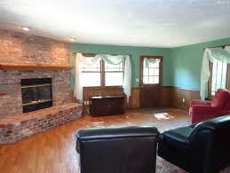 painting wall color to match wood and fireplaces