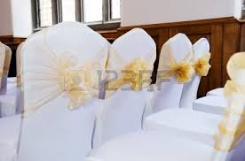 bows for wedding chairs lilac ribbon in a bow on white chair cover at wedding reception