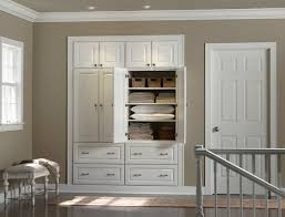 built in hallway cabinets hallway storage closet minneapolis by mid continent cabinetry