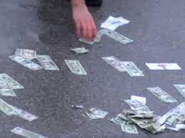 illinois highway covered in gambling money following car crash