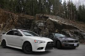 mitsubishi ralliart custom file 2010 mustang and 2010 lancer ralliart jpg wikimedia commons