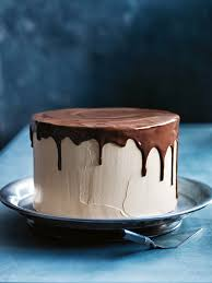 caramel butter cream layer cake with drippy chocolate glaze from