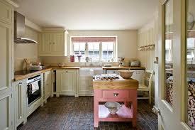 cottage kitchen islands pink kitchen island with butcher block top cottage kitchen