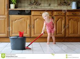 toddler mopping kitchen floor stock photo image 45323313