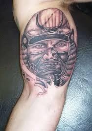 inner bicep grey samurai tattoo