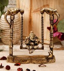 brass ganesha on peacock jhula click on the photo to shop home