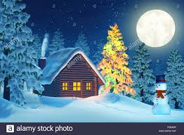 snowy christmas pictures a cabin in a moonlit snowy christmas landscape at night the trees