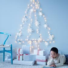 christmas tree shaped lights blue christmas background of de focused lights with decorated tree